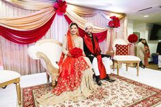 South Asian Wedding, bride, groom, decor, stage, red, gold, jewelry, traditional, Pakistani, staging, couple on stage at their wedding Wedding Shoot, Wedding Bride, Bridal Shower, Baby Shower, South Asian Wedding, Photo Retouching, Red Gold, Staging, Bride Groom
