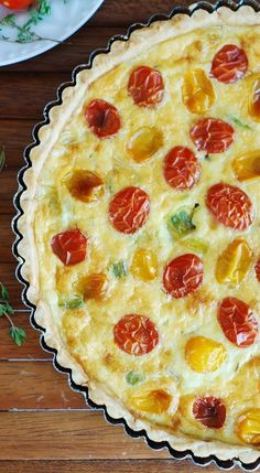 Breakfast quiche with cherry tomatoes.