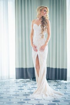 Sophisticated Bride in a Lace Sheath Dress with a Slit | Kane and Social Photography on @BelleMagazine via @aislesociety