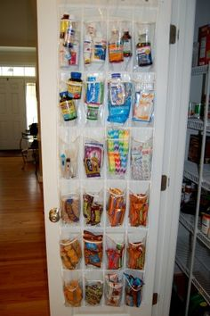 Using clear over the door shoe organizers as every-room organizers:  in the pantry, garage, bedrooms, bathroom, etc.  Good idea!