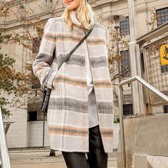 All dressed up for December in our Plaid Funnel Coat.
