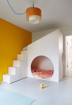 Love the pop of orange, what a cool kid's room.
