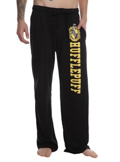 Comfy pajama pants with Hufflepuff design on the left leg, elastic drawstring waist and single button fly.