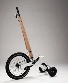 """Half bike by Kolelinia - photo from BBC; """"The minimalistic machine, essentially a hybrid of a tri-wheeled scooter and a rolling, miniature elliptical machine, sprang from the brains of Bulgaria natives Martin Angelov and Mihail Klenov,"""" owners of Kolelinia."""