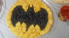 Batman fruit tray for my son's superhero birthday party!  My husband made it with pineapple and blueberries