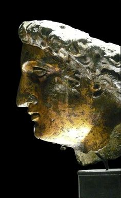 Gilt bronze head from the cult statue of Sulis Minerva.  In localised Celtic polytheism practised in Britain, Sulis was the goddess of the thermal springs that still feed the spas at Bath - which the Romans called Aquae Sulis. Celtic deities often remained to the end associated with a specific place, often a cleft in the earth, a spring, pool or well. The romans were syncretic, linking local gods to their own and built a temple to Sulis Minerva in Bath. Roman Baths Museum.