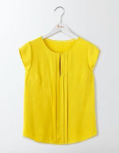 #Boden Pleat Front Top Mimosa Yellow Women Boden, #Turn heads wherever you go in this versatile top. Created from drapey viscose crepe, this style has pretty pleats down the front. Fasten the hook and eye for a clean round neck or wear loose for a soft V-neck shape.