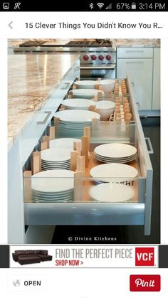 Plates and bowls in pull out cabinet in the kitchen island