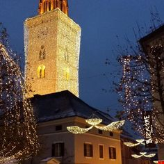 Sankt Jakob kirche illuminated for Christmas, stands at the centre of Advent celebrations at Hauptplatz Villach.