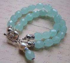 Mia Bella Collection:  bracelet - hand-faceted aqua quartz barrel beads spaced by tiny twinkling faceted seed beads, & finished with lg. silver rounds, AB/rhinestone rondelles, and sm bali sterling spacers along with a lovely beaded dangling charm, $65