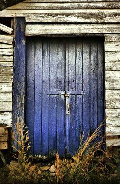 Love blue doors. and old wood.