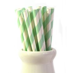 Two packs of Pale green stripe retro paper straws