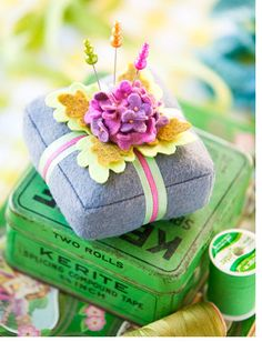 Love this pin cushion idea! Now, if I could only get someone to do all of that tiny intricate cutting for me...