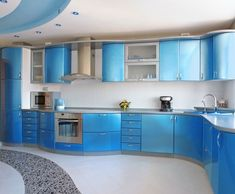 Cool Modern Blue Kitchen Ideas with White Tile Backsplash Furnished with Blue Cabinets and Stainless Steel Countertop Also Completed with Ceiling Lighting Ideas