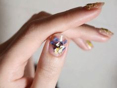 This nail trend involves applying real, dried flowers to your nails. Sign us up!