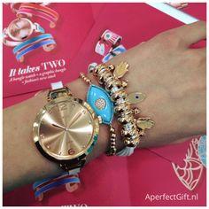 Klein, dun dameshorloge met wit schakel horlogebandje van roségoud RVS