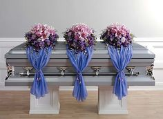 Google Image Result for http://www.funeralflowersbylorraine.com/images/casket_arrangements/page/floral_arrangement_fabric_drape.jpg