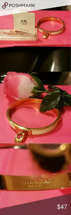 """Coach Rose God Hinged Bracelet COACH COACH JEWELRY COLLECTION  STAINLESS ROSE GOLD TONE CHALK WHITE ENAMEL FILL BANGLE BRACELET / COACH """"C"""" CHARM  BRAND NEW 54495 RETAIL $135  Here are the specs . . . Measures at widest opening - 2 5/16"""" - 5/16"""" width of band ROSE GOLD TONE BRACELET with chalk white enamel fill.  COACH 'C' CHARM attached - great look! Closure - push release hinge Not intended for girls under 12 years of age Coach Jewelry Bracelets Bangle Bracelets, Bangles, Coach Jewelry, White Enamel, Specs, Jewelry Collection, Fill, Shop My, Retail"""