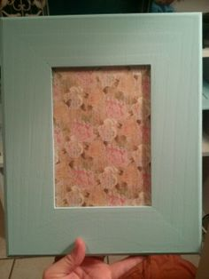 Put cardboard back in the frame.