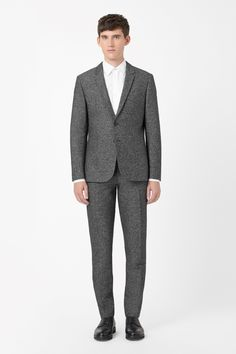 SALT-AND-PEPPER BLAZER  A slim tailored fit with narrow notched lapels, this blazer is made from a tactile blend of cotton and wool with a distinct salt-and-pepper quality. Fastening with two buttons at the front, it has a silky lining, welt front pockets and two vents on the back.