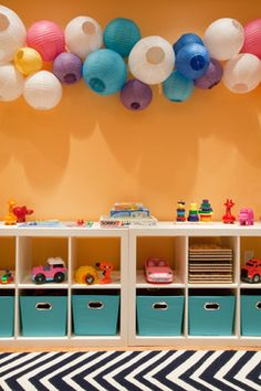 love the paper lantern lights for playroom!
