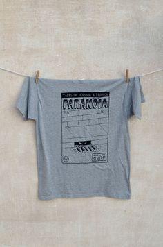 Paranoia T-shirt. Black print on grey t-shirt 85% cotton + 15% viscose