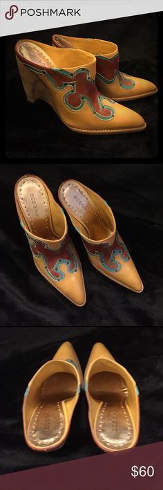 BCBGirls Bosy Mule 9 Leather Gorgeous BCBGirls mules! Retired Bosy style. NWB. Dark yellow, turquoise and ginger. Heel measured from the back is 4.5 inches. Three inches from the side. They are steep, high, and sexy. Brand new in the box. There is a smoker in my house. BCBGirls Shoes Mules & Clogs