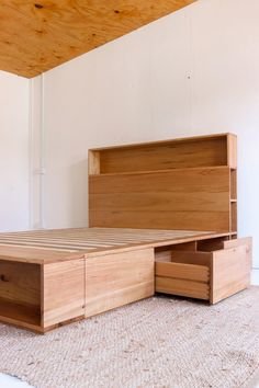 Ultimate storage solution - our custom Bookshelf Drawer Bed features 6 drawers in the platform base and a bookshelf bedhead. Handmade from solid locally sourced Australian hardwood. Bookshelf Headboard, Bed Headboard Design, Bedroom Bed Design, Bedroom Furniture Design, Small Room Bedroom, Headboards For Beds, Bedroom Decor, Bed Designs With Storage, Bed Frame With Storage