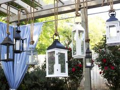 "How to Host a Beach-Themed Wedding Shower : Dress up your dining area with a candelabra made from a grouping of disparate lanterns. Gather an odd number of lanterns in assorted shapes, sizes and finishes. Suspend them at different lengths from an old wooden ladder using 1""-thick nautical sisal rope, ensuring balanced positioning. Secure tops of lantern ropes to ladder rungs using bundling wire. From DIYnetwork.com"