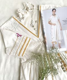 Featuring an ivory front open cape/kurta with hand embroidery and mirror work detailing, paired with embroidered pants and printed dupatta with tassels. #handembroidered #mirrorwork #handmade #skirt #skirtset #indiandesignerwear #madeinindia #dress #indianwear #suitset #suits #womenswear #fashion #kurta #kurtaset #dresses #women #womenwear #designerwear #ootd #stylish #classic #tassles #indianoutfits #fesve #festiveseason #tassles #print #printeddress Dress Sites, White Lotus, Before Sunset, Mirror Work, Indian Designer Wear, Indian Wear, Indian Outfits, Hand Embroidery, Skirt Set