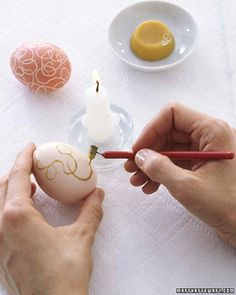If you draw on eggs with wax and then dip them in dye, the color doesn't adhere to the wax -- so when you melt it away, you reveal the design. Use a stylus to apply wax in refined, precise patterns, or try a crayon for simple motifs.