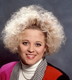 More 80's hair!  Over-permed/crimped and over-colored....