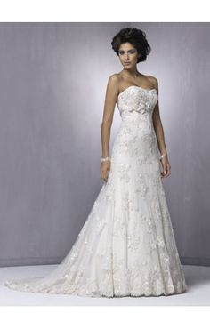 Think this is the one, Maggie Sottero, but in champagne over light gold, and all the sparkle taken off