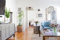 Feminine living space with a large vintage mirror, and a large Morrocean area rug