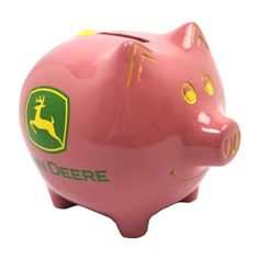 """John Deere Pink Piggy Bank. 5 1/4"""" long 4"""" wide and 4 1/2"""" tall. Sold as each. Made of poly resin. Pink piggy bank with yellow painting and John Deere logo on each side. Coin slot on pig's back and plug on underside of pig."""