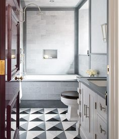 Top 10 Gorgeous Graphic Floor Tile Ideas   House & Home   An inlaid tile mosaic has an Art Deco feel that lends glamour to this eat-in kitchen. It frames the hefty wooden island and subtly references the graphic upholstery on the stools