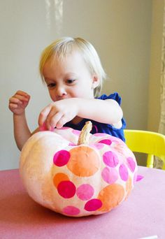Halloween craft: Easy no-carve tissue polka dot pumpkins that even toddlers can help with. | tutorial at Young House Love