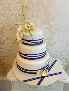 Nice ribbon effect and you could get your florist to do an arrangement like this I reckon.