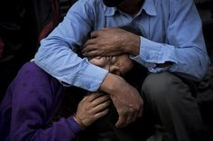 A woman is comforted during the funeral of her mother, a victim of Saturday's earthquake in Kathmandu, Nepal, Friday, May 1, 2015. The U.N. said the quake affected 8.1 million people, more than a fourth of Nepal's population of 27.8 million, and that more than 1.4 million needed food assistance. (AP Photo/Bernat Amangue)