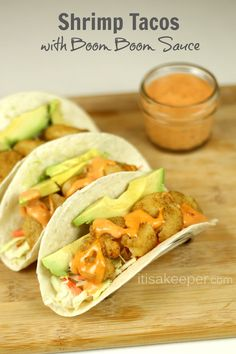 These Shrimp Tacos with Boom Boom Sauce are one of my favorite 30 minute meals and easy recipes. If you are looking for a quick dinner idea, look no further!