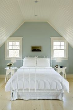 Aquidneck Properties.  subtle blue with original white trim. Add some bold pattern print at windows and foot of bed, and voila!