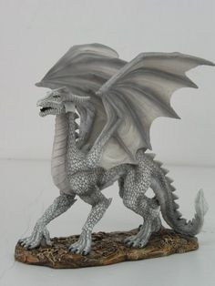 The Last Enchanter White Dragon Statue: Amazon.ca: Home & Kitchen