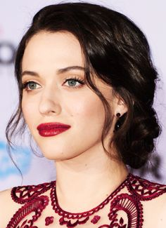 Kat Dennings - I love the hair, lipstick, earrings, color and print of the dress...perfection.
