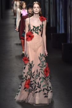 We'd really love to see all these runway gowns at the Met Gala (like this floral Gucci dress). Click to see all the pictures.