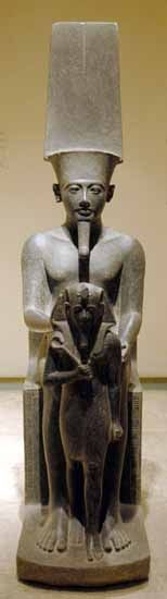 Statue of a diminutive Horemheb standing before before Amun. Carved in Diorite from the Luxor Temple
