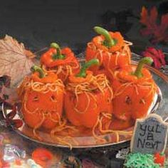 """""""Worms for brains"""":  spaghetti with meat sauce served in orange peppers carved to look like pumpkins!"""