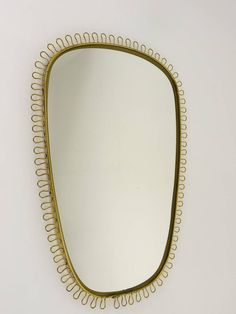 Beautiful Viennese Brass Loop Mirror Attributed to Josef Frank, 1950s | From a unique collection of antique and modern wall mirrors at https://www.1stdibs.com/furniture/mirrors/wall-mirrors/