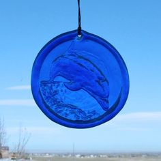 Window Suncatcher Dolphin in Blue Hanging Glass Suncatcher - 4.25 in Dia. Made From Recycled Glass by The Glass reFactory. $12.65. Recycled suncatchers made from bottles.  A unique, sparkly, and beautiful gift that says you care about conserving resources.  These dolphin suncatchers with nature-inspired designs are made from 100 percent recycled bottles collected at a non-profit recycling facility.    Color variations are to be expected since a wide varie...