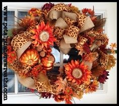 "Beautifully handcrafted fall wreath filled with gorgeous artificial fall flowers, feathers, acorns, pumpkins, lush greenery, and decadent burlap and leopard ribbon. This autumn wreath measures approx: 26"". Free US shipping on all fall wreaths!"