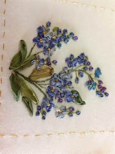 Beautiful silk ribbon blooms are showcased in this floral sampler of ...
